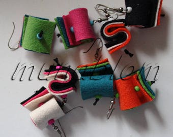 HOR: Earrings made of colored cloth.