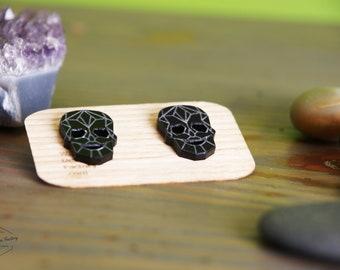Black organic glass skull earrings