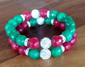 Handmade holiday themed stretch yoga bracelet set. Features red and jade gemstone 10mm beads and rhinestone pave disco focal beads.