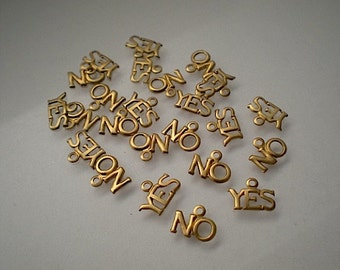 24 tiny brass YES and NO charms