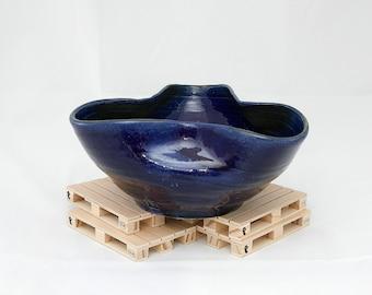Stoneware centerpiece-fruit bowl. TStoneware table cante, tray.