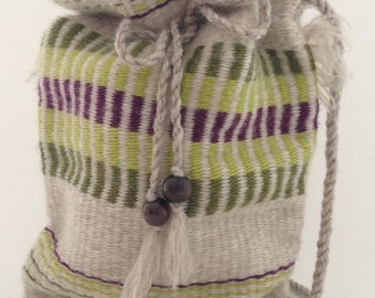 Hand woven bag with a drawstring closure. 100% wool
