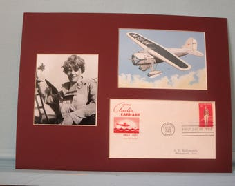 Amelia Earhart - The First Female to fly solo across the Atlantic Ocean in her Veha Airplane& First Day Cover of her own stamp