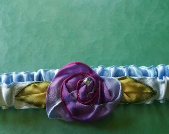 silk garter in a nontraditional something blue with a violet hand stitched ribbon rose