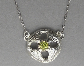 Sterling silver Eucalyptus seed necklace set with a yellow diamond.
