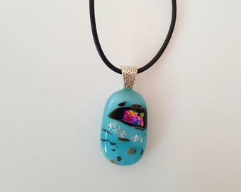 Blue and pink reactive glass pendant