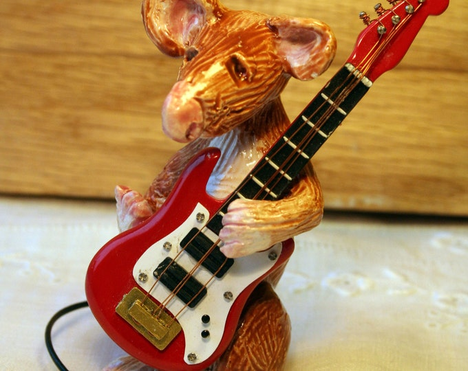 A Musical Mouse called Eric. Eric will bring his own red guitar to his new home. All he needs is love and a warm spot to stand.