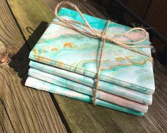 Gorgeous 4pc ceramic coaster set in peach/mint and hints of gold