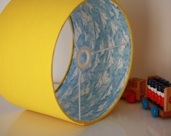 Drum lampshade lined with clouds on sky fabric available in with a choice of outer shade fabric