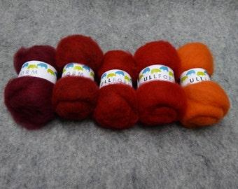 Norwegian carded wool fleece in bundles of red colours
