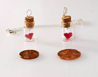 Pendant origami paper heart in tiny glass bottle