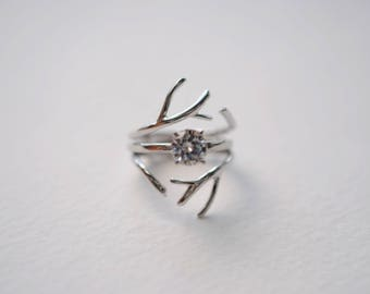 Moissanite Solitaire Engagement Ring in White Gold with Double Outward Enhancer