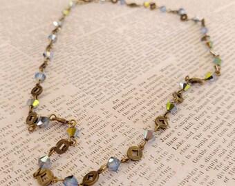 Pale Cornflower Blue Swarovski Crystals on a Gold-Plated Brass Diamond Motif  Gold-Plated Brass Chain