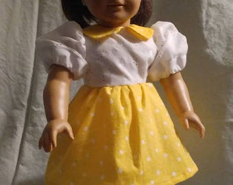 Combo dress w/white eyelet lined top and yellow polka-dot skirt