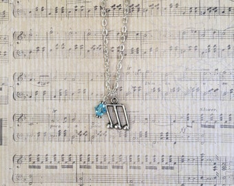 Eighth note silver charm necklace with light blue Swarovski crystal accent
