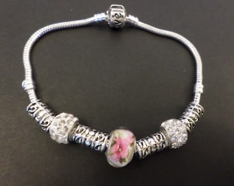 Silver charm bracelet complete with Murano glass beads