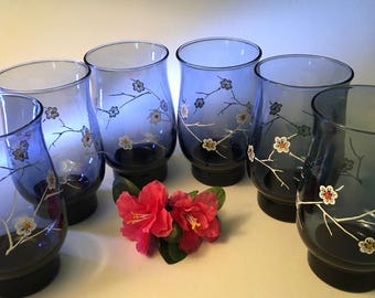 One set of six Libbey blue glasses with a white floral daisy dogwood design