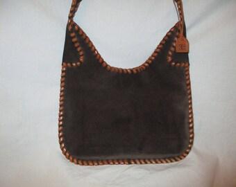 El Portal suede whip stitch bag