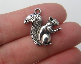 4 Squirrel pendants antique silver tone A46