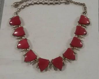 Goldtone necklace,red plastic