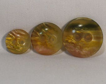 Set of 8 vintage buttons, amber, with 3 different diameters