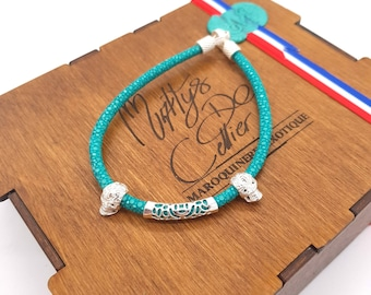 Bracelet turquoise and silver stripe solid skull