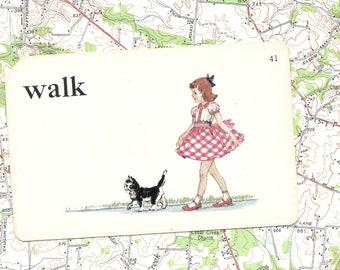 WALK/girl/cat/gingham dress/action/ Vintage Vocabulary Flashcard