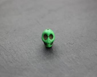 Green skull bead