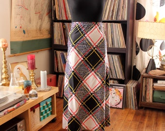 vintage 1960s maxi skirt by Cos Cob, slim fit with oversized plaid print . womens large