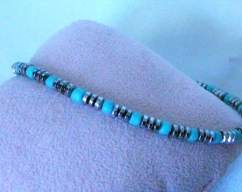 MINIMALIST MAGNETIC BRACELETS. African turquoise and silver hematite magnetic disc beads combine to make this charming minimalist bracelet