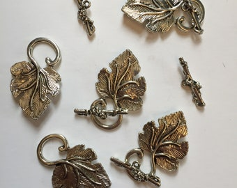 Package of 5 Antique Silver Toggle Clasps. Base metal finding. Decorative Grape Leaf clasp. 1.5 inches long clasped.