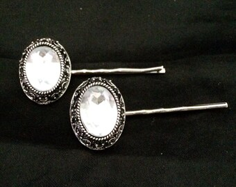 Set Of 2 Silver Metal Hair Pins Featuring Oval Ornaments With Large Faceted Crystals