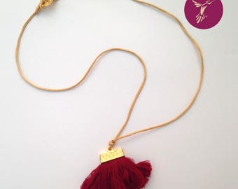 Golden necklace with Crimson tassel