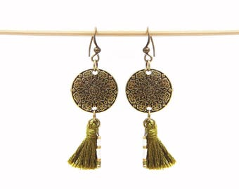 Ethnic earrings and khaki tassel