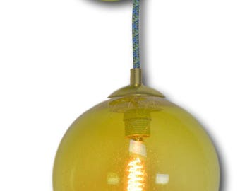Lime Green Industrial Seeded Hand Blown Glass Round Wall Sconce with fabric cord.