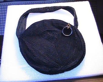 Round black brocade fabric handbag