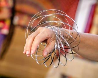 Flow Rings   Kinetic Sculpture   Toroflux   Arm Slinky   Dance Toy