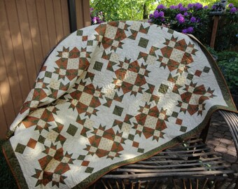 """This one is a beauty.  Golden Brown and Olive Green Quilt with Cream Background   54"""" x 71"""""""