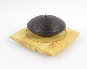 Candle holder wooden candle flat and round black object of decoration of pine wood