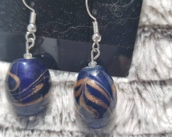 Blue glass earrings with gold swirl