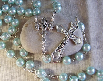 Catholic rosary handmade in silver with light blue glass pearls