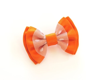 orange satin bow and white tulle brooch