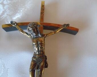 small gold tone metal crucifix
