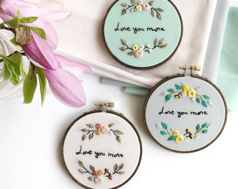 Love You More, hand embroidered on your choice of blush, grey or mint fabric, new baby gift, graduation gift, grandma gift, embroidery hoop