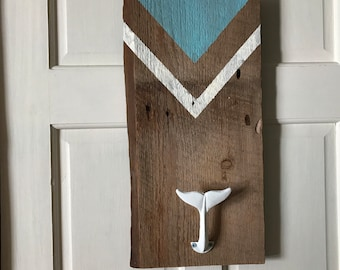 Wall decoration in authentic barn wood and whale tail hook, detail triangle painted in beige and light blue