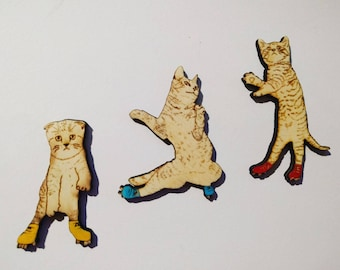 Brooches cat trio on roller skates