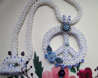 White Beaded Peace Sign with Blue Accents