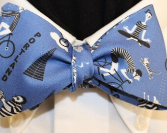 PORTLAND BLUE--Handmade bow tie in novelty cotton, colorful scenes of Portland life on a blue field; for well dressed persons