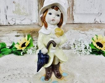 Ceramic Figurine/Girl with Doll & Umbrella/Mann Bisque/Home Decor/Rain/Navy Blue/Yellow/Glazed/LUV-20/Japan/Vintage