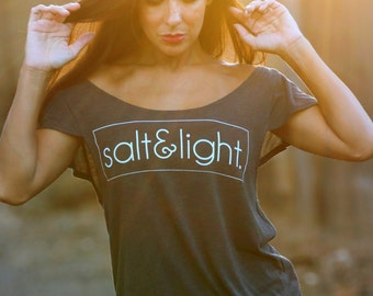 Salt & Light Tee. Off the Shoulder Flutter Sleeve Flowy Muscle Tee. Made in the USA. Off the Shoulder Lounge Tee. Women's Quote Shirt.